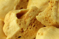 Cinder Toffee Close-up. Macro closeup of pieces of cinder toffee royalty free stock photography
