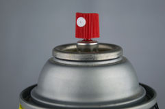 Macro closeup of a red and white nozzle on top of a silver can o Royalty Free Stock Photos