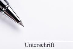 Macro closeup sign document contract pen filler Stock Photos