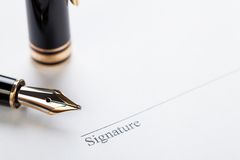Macro closeup sign document contract pen filler Royalty Free Stock Image