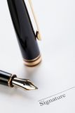Macro closeup sign document contract pen filler Royalty Free Stock Images