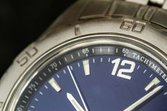 Macro closeup of a silver watch face Royalty Free Stock Photography