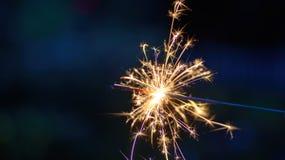 Beautiful macro closeup of a sparkler at night. Macro closeup of a sparkler glowing and shooting sparks at night Royalty Free Stock Photo