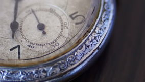 Macro closeup of an vintage clock. Antique clock dial close-up. Vintage pocket watch,A macro closeup of an vintage clock.Old vintage clock mechanism watch time stock video footage
