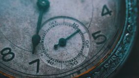 Macro closeup of an vintage clock. Vintage pocket watch.Old vintage clock mechanism watch time going fast. Antique clock dial close-up. A macro closeup of an stock footage