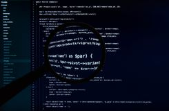 Macro code of web site under magnifying lens royalty free stock photography