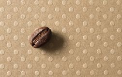 Macro of a Coffee Bean. Macro photo of a Coffee Bean on dotted ground royalty free stock photography