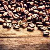 Macro Coffee beans on grunge wooden background. Fresh Roasted co Royalty Free Stock Photo