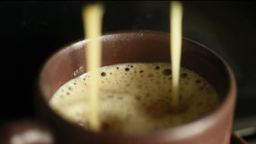 Macro coffee from coffee machine stock video footage