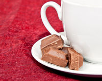 Macro of coffee cup and chocolate blocks Stock Image