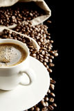 Macro coffee with foam and sack at breakfast on black background Stock Images