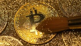 Bitcoin Brushed from Sparkles Made As Virtual Currency Macro. Macro coin brushed from sparkles and made as first decentralized bitcoin currency with strictly stock footage