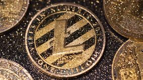 Macro Coins Sprinkled with Sparkles Created As Litecoin Currency. Macro golden coins sprinkled with sparkles and created as litecoin currency used to exchange stock video footage