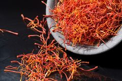 Macro collection, expensive real dried saffron spice close up. On black background Royalty Free Stock Photo