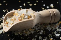 Macro collection, white sea salt mixed with italian herbs, rosem. Ary and spices on black background royalty free stock photos