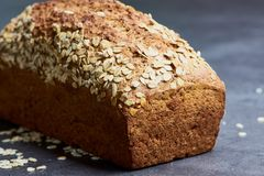 Fresh homemade wholemeal bread on a gray kitchen desk royalty free stock photography