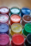 Macro colorful cans of gouache.  Royalty Free Stock Images