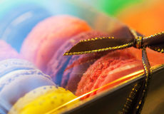 Macro with colorful macaroons in the gift box. With tape. Macro photo with shallow depth of field Royalty Free Stock Images