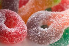 Macro of colorful sugar coated chewy gummy candy. Close up of pile of colourful sugary coated chewy gummy candy royalty free stock image