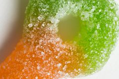 Macro of colorful sugar coated chewy gummy candy. Close up of pile of colourful sugary coated chewy gummy candy. With lots of copyspace stock image