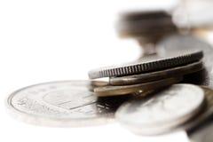 Macro fondo delle monete su bianco Fotografia Stock