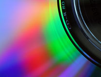 Macro of a compact disc surface, with light diffraction pattern. Macro of the surface of a compact disc, with light being diffracted into a spectrum of colours Stock Photo