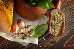 Macro composition of Italian cooking ingredients, garlic, rosema Royalty Free Stock Photo