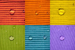 Macro Composition Water Drop on a coloured cloth Stock Image