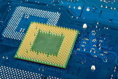 Macro of computer processor on blue motherboard Stock Images