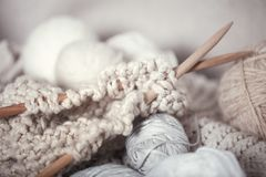 The macro concept of knitting wool and needles royalty free stock photo