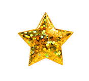 Macro of a confetti gold star Royalty Free Stock Image