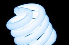 Macro Conservation Bulb. Macro photo of environmental friendly flourescent light bulb Royalty Free Stock Photos