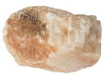 Macro cruda gialla ed arancio della pietra della calcite, isolata Fotografie Stock