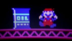 Macro CU 'Mario' il protagonista 'dall'asino Kong' retro Arcade Vide classico video d archivio