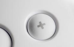 Macro d'un blanc plus le bouton Photographie stock libre de droits
