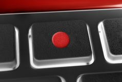 Macro d'un bouton record noir d'un noir à télécommande avec le contre-jour Photographie stock