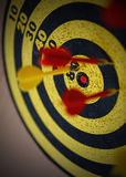 Macro darts in the center of the target Stock Photo