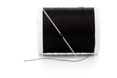 Macro de bobine d'aiguille et de fil de couture Photographie stock