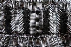 Macro de détail d'habillement avec la dentelle et les boutons Image stock