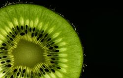 Macro de kiwi pour des amants de nourriture et de boissons Photographie stock