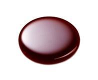 Macro de la gota de chocolate imagen de archivo