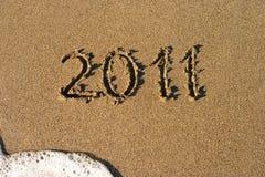 Macro de la playa de la arena con el número 2011 Foto de archivo libre de regalías