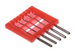 Macro de las agujas de la máquina de coser aislada Imagen de archivo libre de regalías