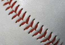 Macro de las costuras del béisbol fotos de archivo