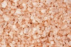 Macro dei cristalli dello zucchero marrone Fotografie Stock