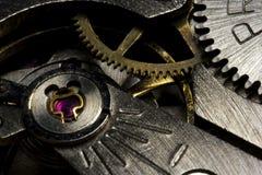 Macro del mecanismo impulsor del reloj Fotografía de archivo libre de regalías