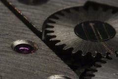 Macro del mecanismo impulsor del reloj Fotos de archivo