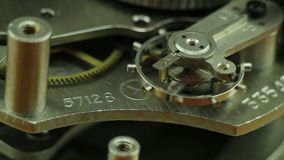 Macro del mecanismo del reloj metrajes