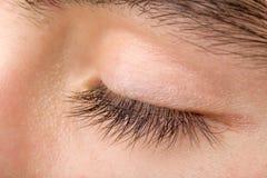 Macro del ojo del hombre del adolescente Imagen de archivo