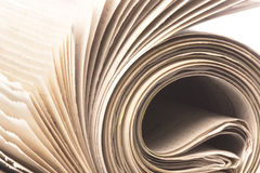 Macro del rodillo del periódico aislada Imagen de archivo